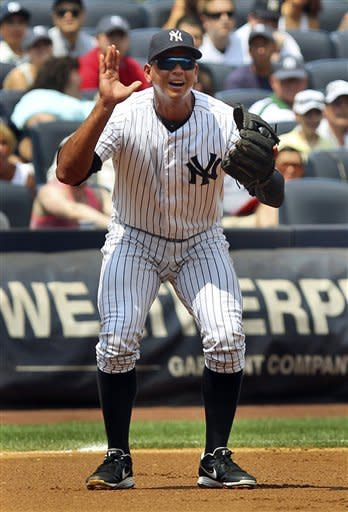 New York Yankees' Alex Rodriguez reacts after committing a throwing error during the first inning of a baseball game against the Toronto Blue Jays, Wednesday, July 18, 2012, at Yankee Stadium in New York. (AP Photo/Seth Wenig)