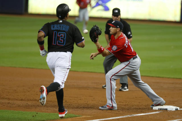 Washington Nationals first baseman Ryan Zimmerman, right, makes the catch to put out Miami Marlins' Starlin Castro, left, during the first inning of a baseball game, Saturday, Sept. 21, 2019, in Miami. (AP Photo/Wilfredo Lee)