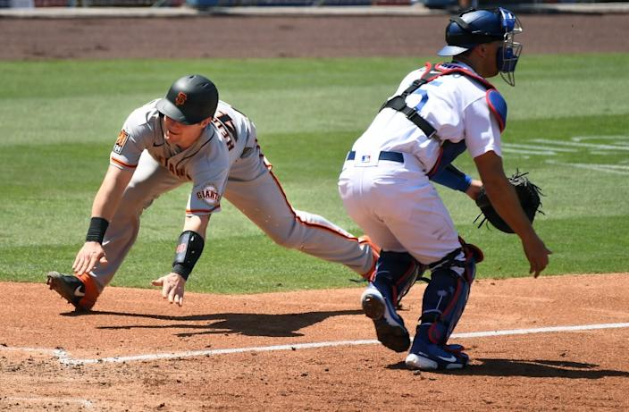 """The Giants' Tyler Heineman scores around Dodgers catcher Austin Barnes on a double by Donovan Solano in the fourth inning Saturday. <span class=""""copyright"""">(Wally Skalij / Los Angeles Times)</span>"""