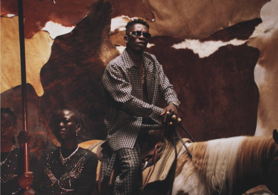 """<p>The Ghanaian singer is featured during """"Already,"""" where he's shown sitting on a throne and a horse.</p>"""
