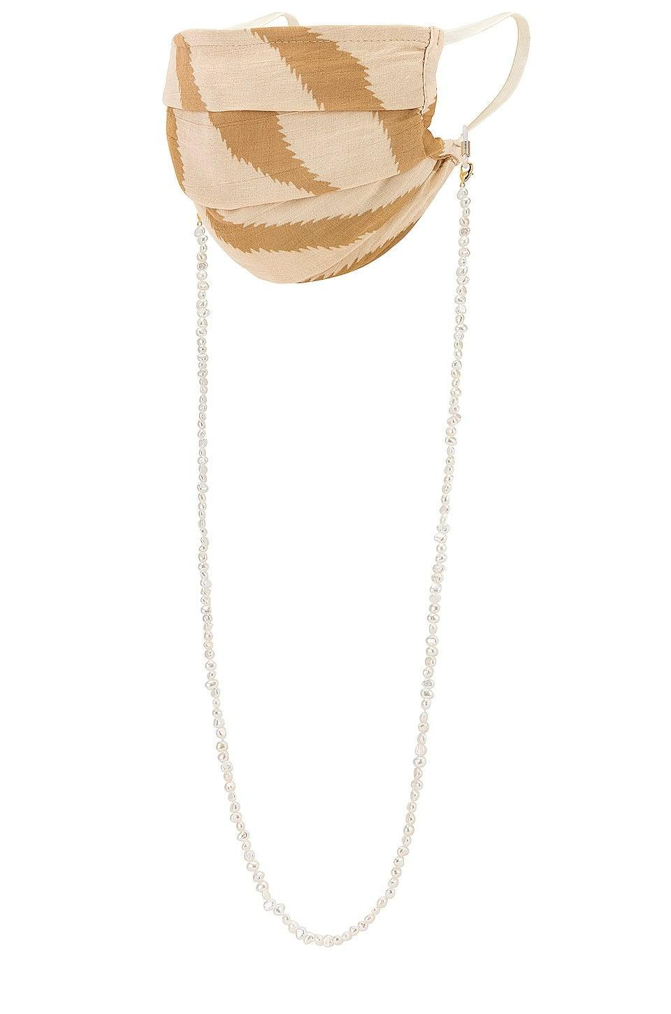<p><span>petit moments Freshwater Pearl Mask Chain in White</span> ($55)</p>