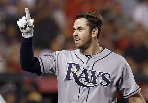 Tampa Bay Rays' Evan Longoria points to the stands after his two-run home run against the Los Angeles Angels in the fifth inning inning of a baseball game in Anaheim, Calif., Thursday, Aug. 16, 2012. (AP Photo/Reed Saxon)