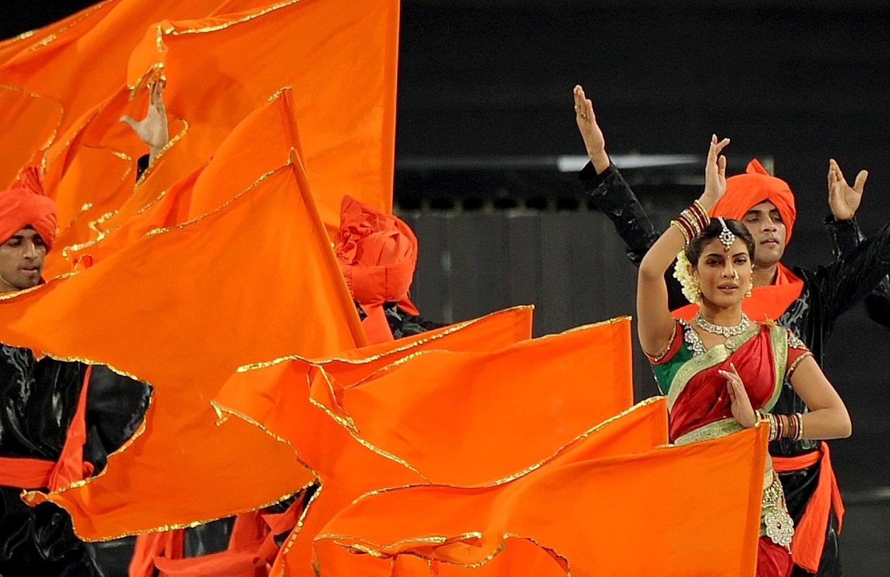 Bollywood actress Priyanka Chopra (2R) performs during a ceremony before the IPL Twenty20 cricket match between Pune Warriors India and Kings XI Punjab at The Subrata Roy Sahara Stadium in Pune on April 8, 2012.