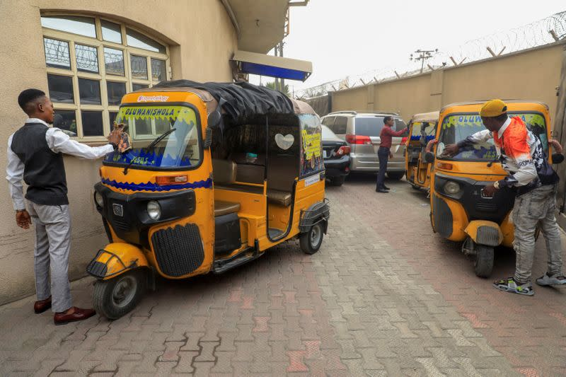 Corporate tricycle riders clean their tricycles popularly known as 'keke' in Lagos
