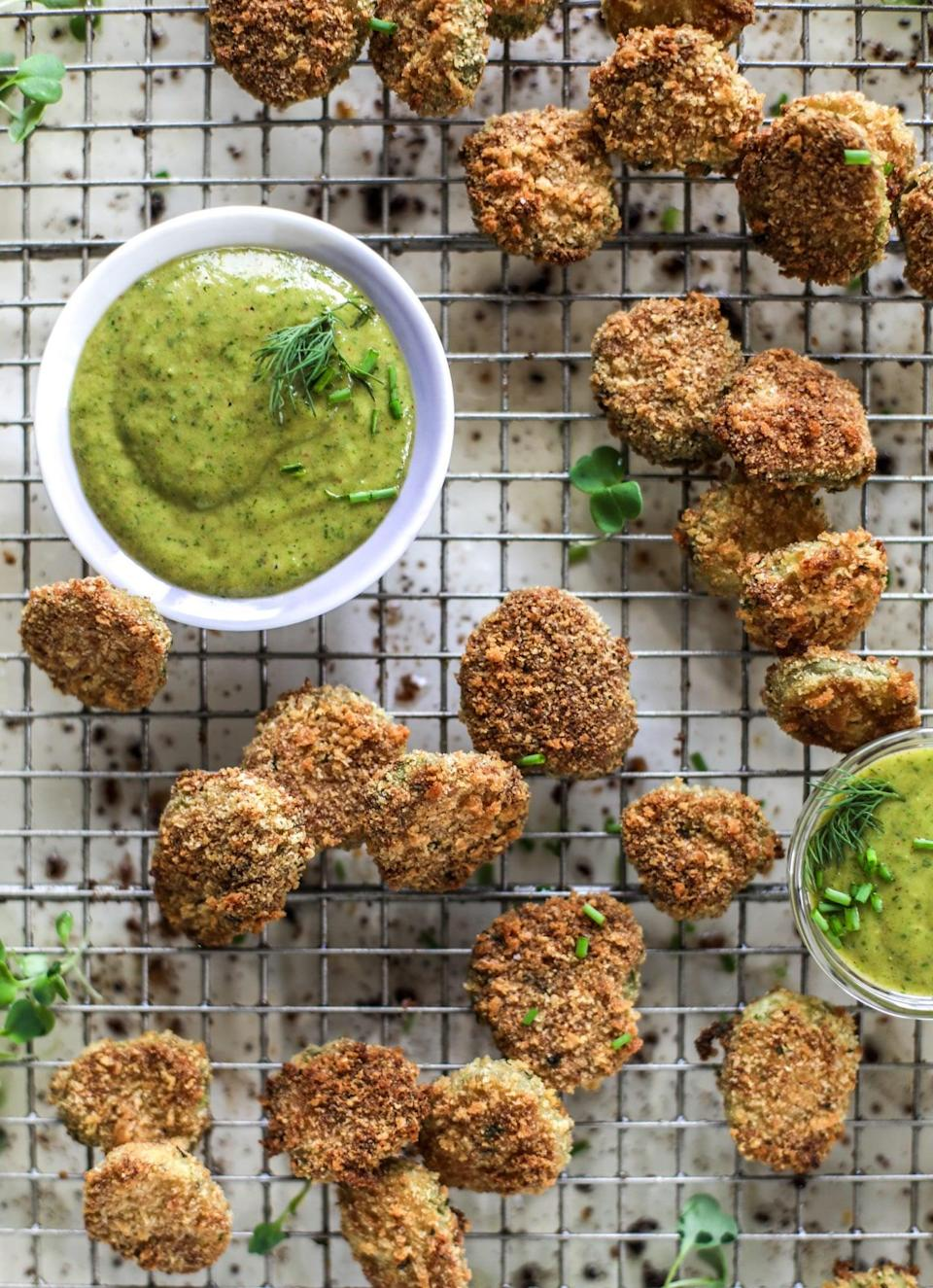 """<p>Pickle fanatics will flip over just how tasty these crispy bites are. They're easy to make and even easier to eat, so stock up on the pickles, please! This recipe makes enough to feed four people, and since these are <em>so</em> good, two people could easy nosh on all of 'em.</p> <p><strong>Get the recipe:</strong> <a href=""""https://www.howsweeteats.com/2019/05/crispy-baked-pickles/"""" class=""""link rapid-noclick-resp"""" rel=""""nofollow noopener"""" target=""""_blank"""" data-ylk=""""slk:oven-fried pickles"""">oven-fried pickles</a></p>"""