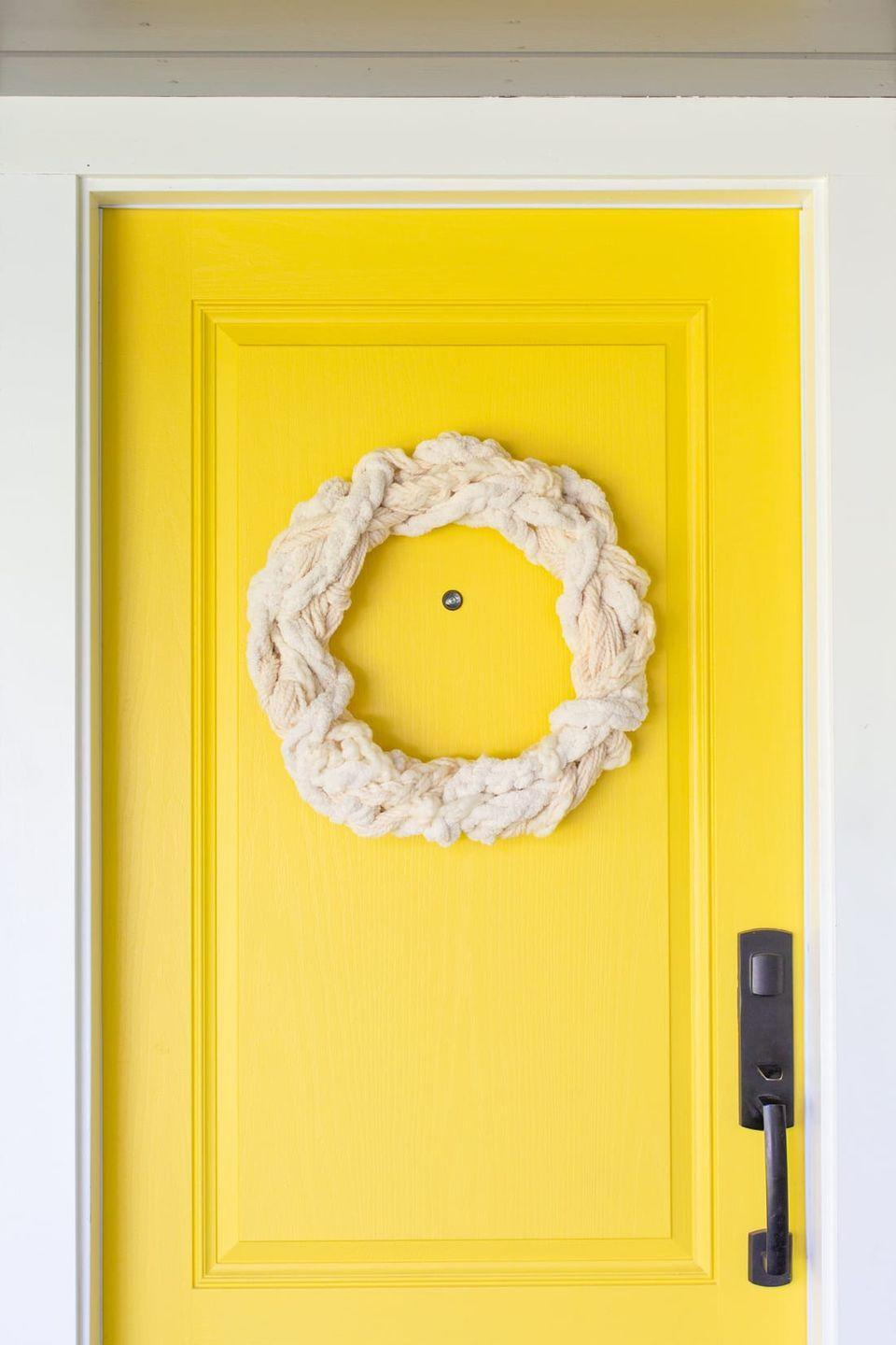 """<p>Consider this soft, textured wreath your front door's favorite chunky knit sweater. </p><p><a class=""""link rapid-noclick-resp"""" href=""""https://lovelyindeed.com/make-a-textured-yarn-wreath-for-fall/"""" rel=""""nofollow noopener"""" target=""""_blank"""" data-ylk=""""slk:GET THE TUTORIAL"""">GET THE TUTORIAL</a> </p>"""