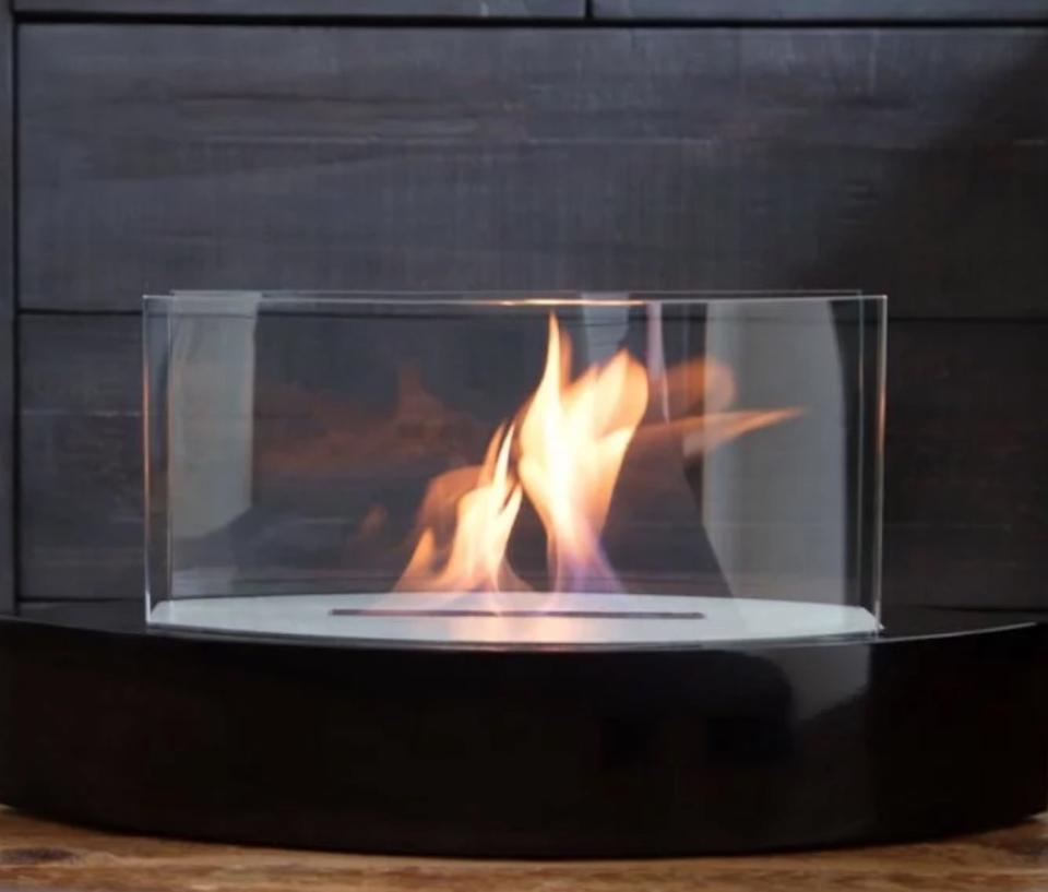 tabletop fireplace with flame in it, fall decorating tips