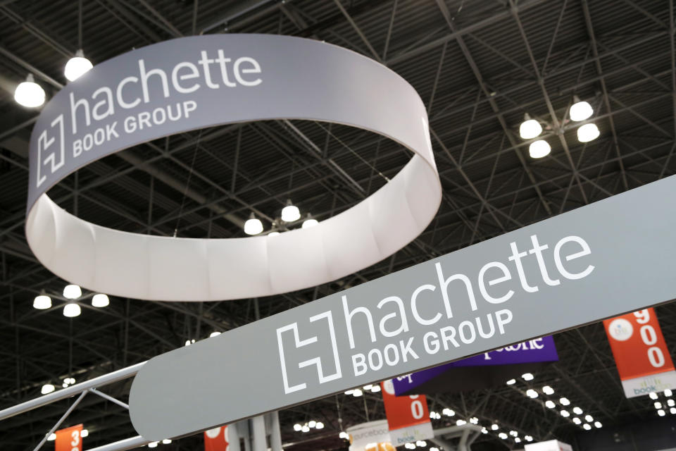 FILE - In this May 28, 2015 file photo, signs for Hachette Book Group are displayed at BookExpo America in New York. The annual publishing convention and trade show, a decades-old tradition, may be coming to an end. ReedPop, which has managed BookExpo for a quarter century, announced Tuesday that it was dropping the event, along with the fan-based BookCon. (AP Photo/Mark Lennihan, File)
