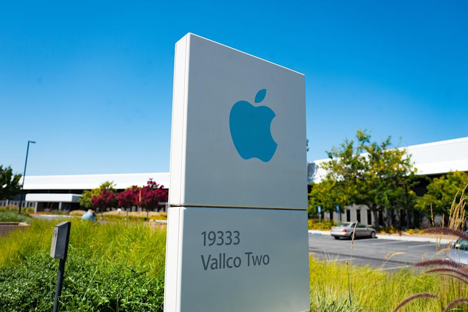 Low-angle view of blue colored sign with logo and buildings near the headquarters of Apple Computers in the Silicon Valley, Cupertino, California, August 26, 2018. (Photo by Smith Collection/Gado/Getty Images)