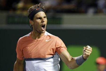 Mar 25, 2014; Miami, FL, USA; Rafael Nadal celebrates after his match against Fabio Fognini (not pictured) on day nine of the Sony Open at Crandon Tennis Center
