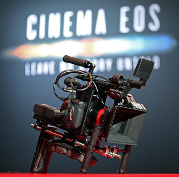 One in the line of new EOS C300 interchangeable-lens digital cinema cameras, is seen with many added features at the introduction of the Cinema EOS System, Canon's all-new lineup of professional motion picture cameras and lenses, at Paramount Studios in Los Angeles Thursday, Nov. 3, 2011. The Cinema EOS offers compatibility with Canon's existing array of EF lenses used in digital single-lens reflex cameras, including the existing video-capable EOS 5D Mark II. (AP Photo/Reed Saxon)