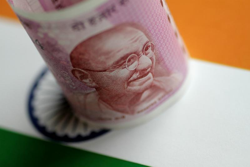 Indian Rupee Will Stay Weak Against Dollar Until Coronavirus Pandemic Subsides: Poll