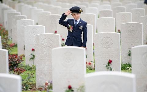 Six-year-old George Sayer paying tribute to his great uncle, who landed on Sword Beach on D-Day - Credit: Paul Grover