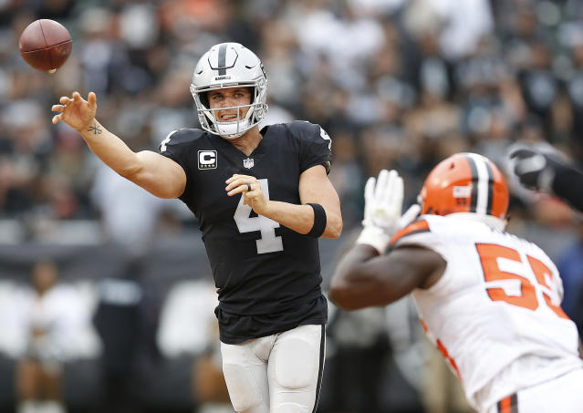 "<a class=""link rapid-noclick-resp"" href=""/nfl/players/27564/"" data-ylk=""slk:Derek Carr"">Derek Carr</a> continued a stunning trend of quarterback play this season in Week 4. (AP Photo/D. Ross Cameron)"