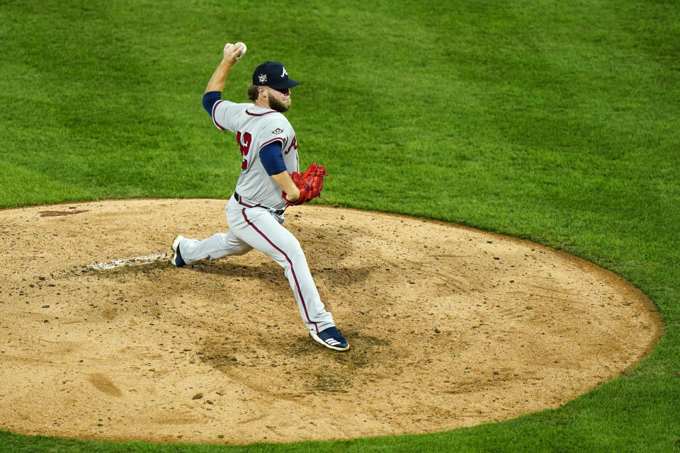 Atlanta Braves' A.J. Minter pitches during the sixth inning of a baseball game against the Philadelphia Phillies, Friday, Aug. 28, 2020, in Philadelphia. (AP Photo/Matt Slocum)