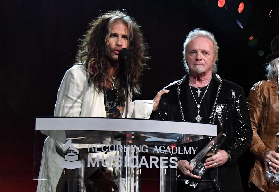 Aerosmith's Steven Tyler and Joey Kramer onstage at the 2020 MusiCares Person of the Year gala. (Photo: Kevin Mazur/Getty Images for The Recording Academy)
