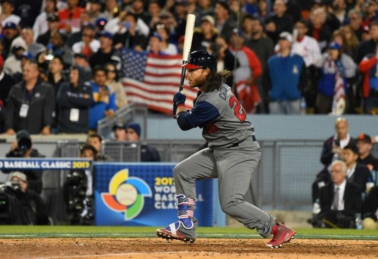 Brandon Crawford of team United States hits a 2-RBI single in the seventh inning against team Puerto Rico during the 2017 World Baseball Classic