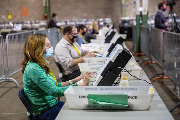 Poll workers tabulate ballots at the Allegheny County Election Warehouse in Pittsburgh