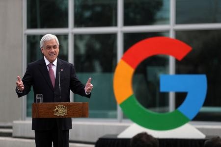 Chile's President Sebastian Pinera delivers a speech near a Google logo during the announcement of the plans for their data centre expansion in Santiago, Chile, September 12, 2018. REUTERS/Ivan Alvarado