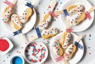 """<p>Let freedom ring with these patriotic Nutter Butter cookie pops, which are coated with white chocolate and sprinkled with red and blue sanding sugar. </p><p><strong><em>Get the recipe for <a href=""""https://www.delish.com/cooking/recipe-ideas/recipes/a42971/freedom-cookie-pops/"""" rel=""""nofollow noopener"""" target=""""_blank"""" data-ylk=""""slk:Freedom Cookie Pops"""" class=""""link rapid-noclick-resp"""">Freedom Cookie Pops</a>. </em></strong></p>"""