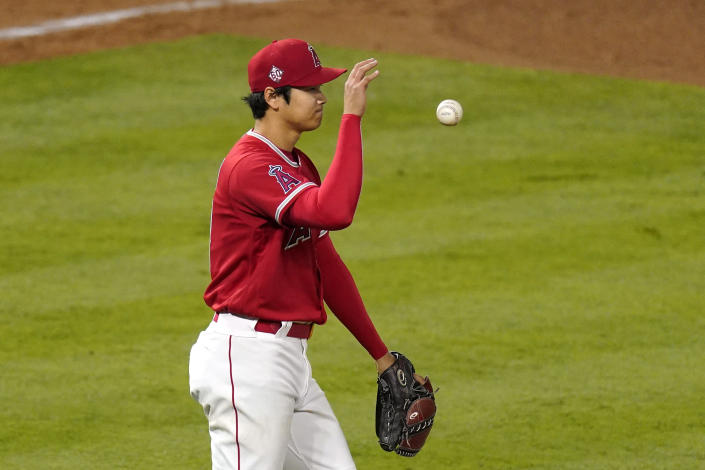 Los Angeles Angels starting pitcher Shohei Ohtani tosses the ball after walking Tampa Bay Rays' Joey Wendle during the sixth inning of a baseball game Wednesday, May 5, 2021, in Anaheim, Calif. (AP Photo/Mark J. Terrill)