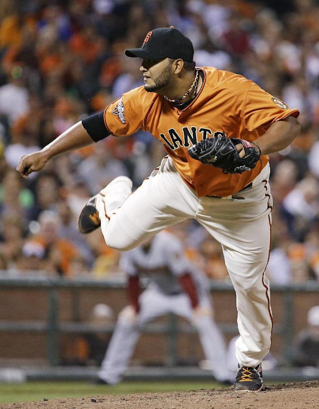 San Francisco Giants starting pitcher Yusmeiro Petit throws against the Arizona Diamondbacks in the fifth inning of their baseball game, Friday, Sept. 6, 2013, in San Francisco. (AP Photo/Eric Risberg)