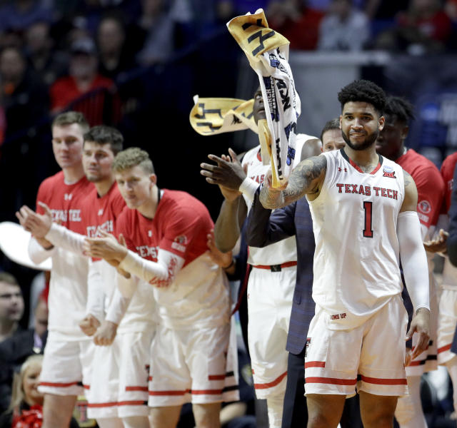 The Texas Tech bench celebrate after a basket during the second half of a first round men's college basketball game against Northern Kentucky in the NCAA Tournament Friday, March 22, 2019, in Tulsa, Okla. Texas Tech won 72-57. (AP Photo/Charlie Riedel)