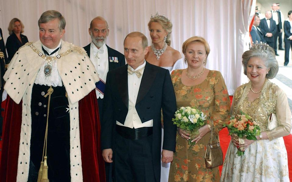 Prince Michael and Vladimir Putin pose for photographers during a 2003 reception at London City Hall - SERGEI VELICHKIN