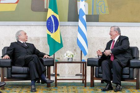 Greece's ambassador to Brazil, Kyriakos Amiridis (R), talks to Brazil's President Michel Temer during a government ceremony in Brasilia, Brazil May 25, 2016. Beto Barata/Brazilian Presidency/Handout via REUTERS