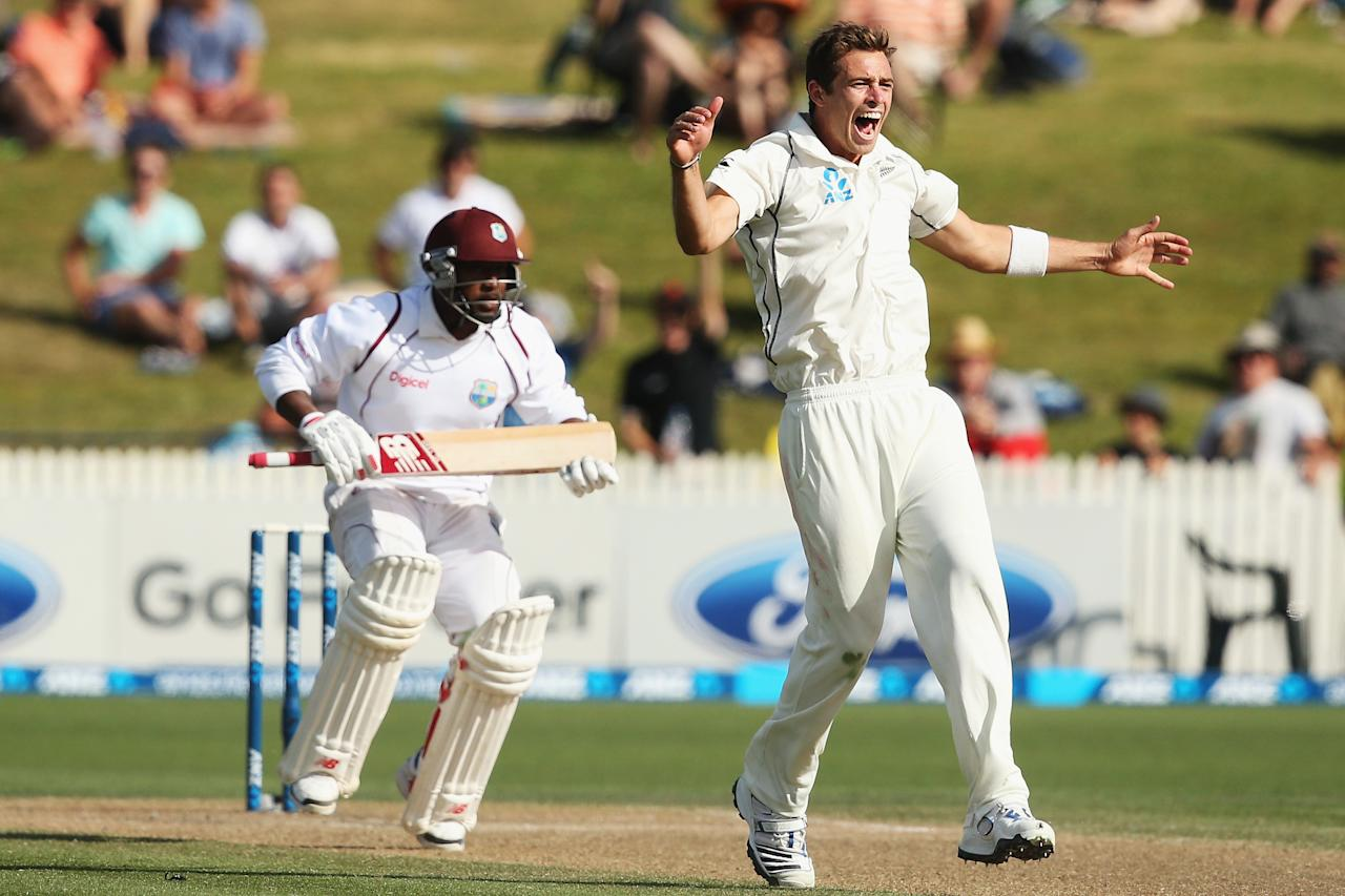 HAMILTON, NEW ZEALAND - DECEMBER 21:  Tim Southee of New Zealand celebrates claiming the wicket of Tino Best of the West Indies during day three of the Third Test match between New Zealand and the West Indies at Seddon Park on December 21, 2013 in Hamilton, New Zealand.  (Photo by Hannah Johnston/Getty Images)