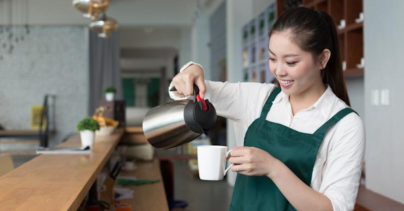 Woman working part time at a coffee shop