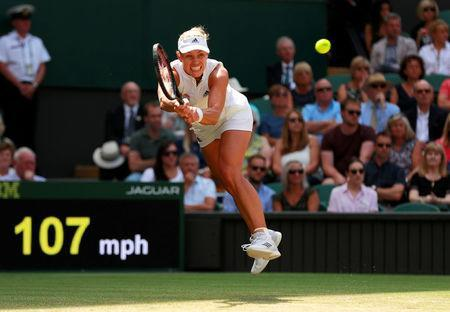 Tennis - Wimbledon - All England Lawn Tennis and Croquet Club, London, Britain - July 12, 2018. Germany's Angelique Kerber in action during her semi final match against Latvia's Jelena Ostapenko. REUTERS/Andrew Couldridge