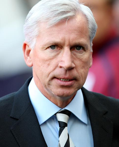 Newcastle United's manager Alan Pardew, looks on ahead of their English Premier League soccer match against Manchester United at the Sports Direct Arena, Newcastle, England, Sunday, Oct. 7, 2012. (AP Photo/Scott Heppell)
