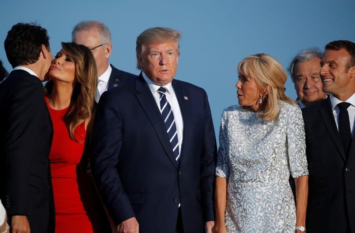 """<div class=""""inline-image__caption""""> <p>First Lady Melania Trump kisses Canada's Prime Minister Justin Trudeau next to the U.S. President Donald Trump, Brigitte Macron, wife of French President Emmanuel Macron, and French President Emmanuel Macron during the family photo with invited guests at the G7 summit in Biarritz, France, August 25, 2019.</p> </div> <div class=""""inline-image__credit""""> CARLOS BARRIA </div>"""