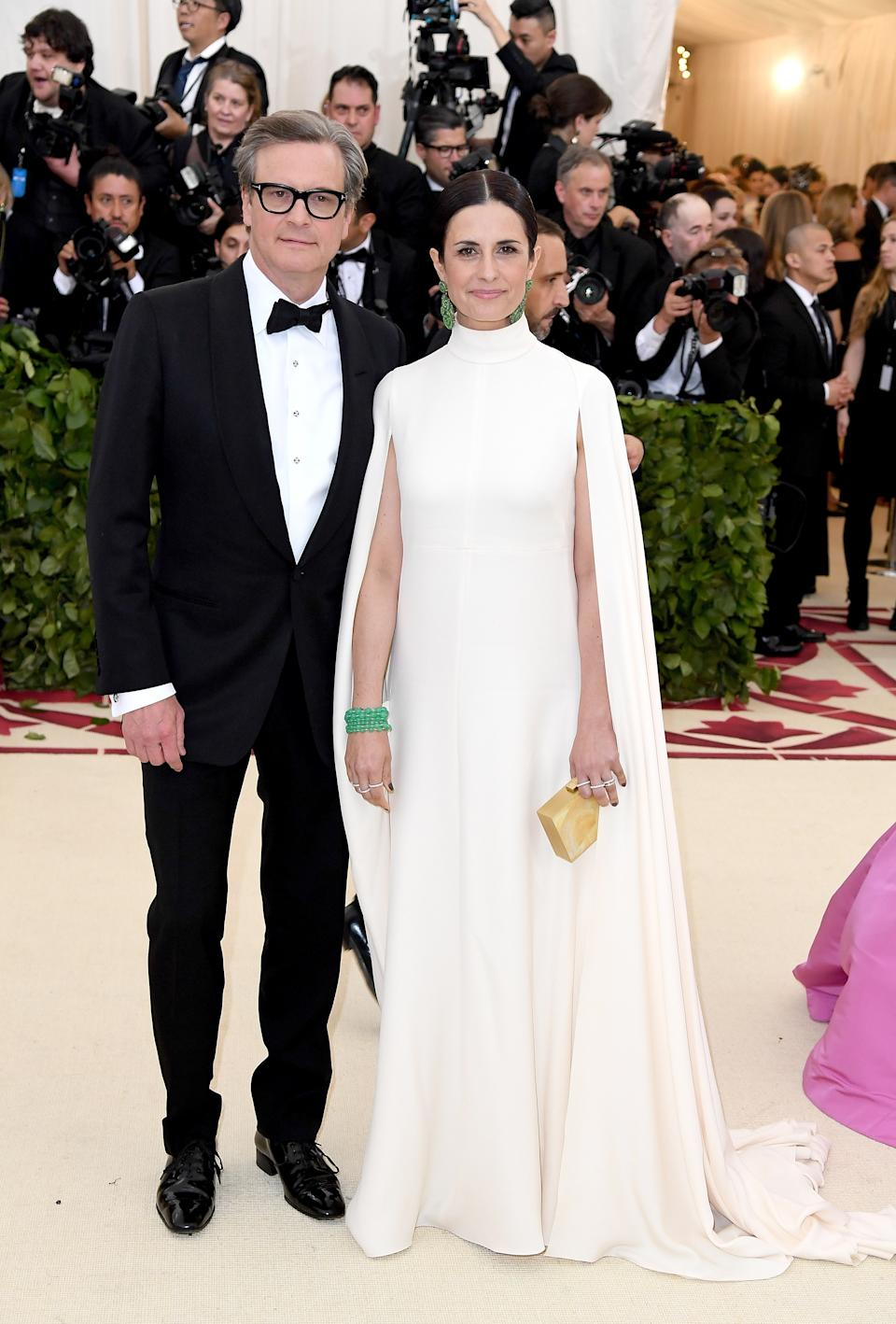 """<h1 class=""""title"""">Colin Firth and Livia Firth in Giambattista Valli and Chopard jewelry</h1><cite class=""""credit"""">Photo: Getty Images</cite>"""
