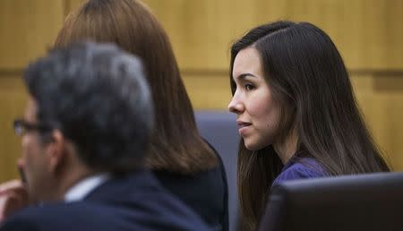 Jodi Arias (R) looks at her attorneys during the sentencing phase retrial in Phoenix March 3, 2015.   REUTERS/Tom Tingle/Pool