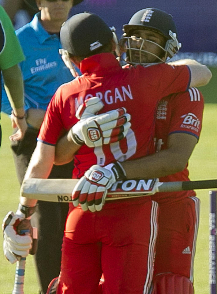 England's Eoin Morgan and Ravi Bopara celebrate winning the One Day International at The Village, Dublin.
