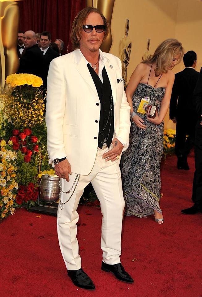 """Mickey Rourke   Grade: D       Despite his adorable necklace (commemorating his recently deceased Chihauhua, Loki), the rugged """"Wrestler"""" looked rough on the red carpet in a sloppy suit and silly accessories."""