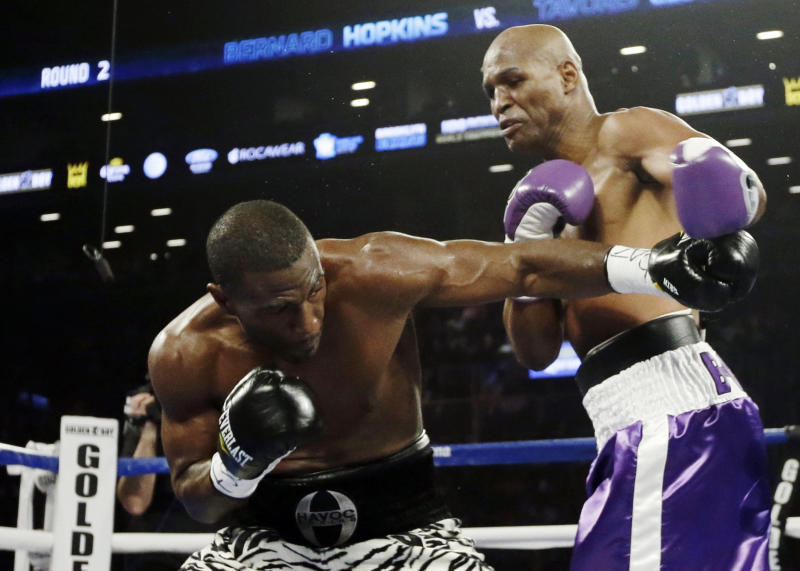 Bernard Hopkins and Tavoris Cloud fight during the fourth round of an IBF Light Heavyweight championship boxing match at the Barclays Center Saturday, March 9, 2013, in New York. (AP Photo/Frank Franklin II)