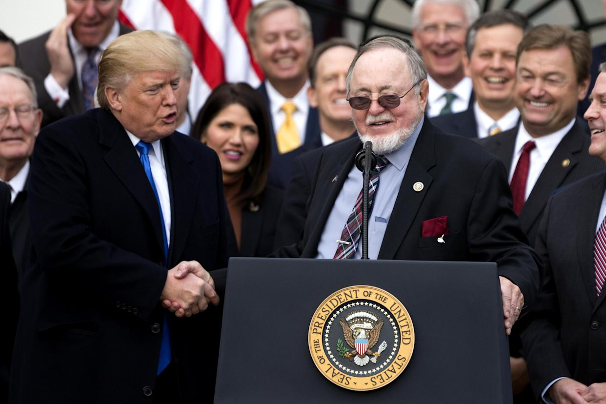 President Trump shakes hands with GOP Rep. Don Young of Alaska at the White House after Congress passed the Tax Cuts and Jobs Act, Dec. 20, 2017. (Photo: Alex Edelman/ZUMA Wire)