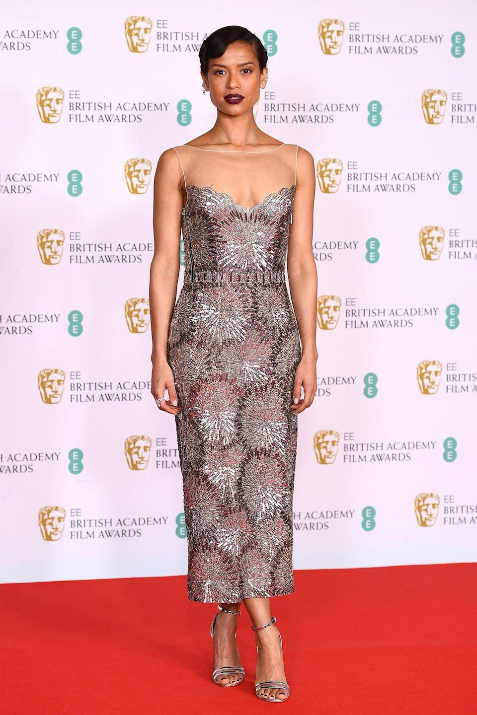 <p>The actor wore a silver midi dress by Louis Vuitton. </p>