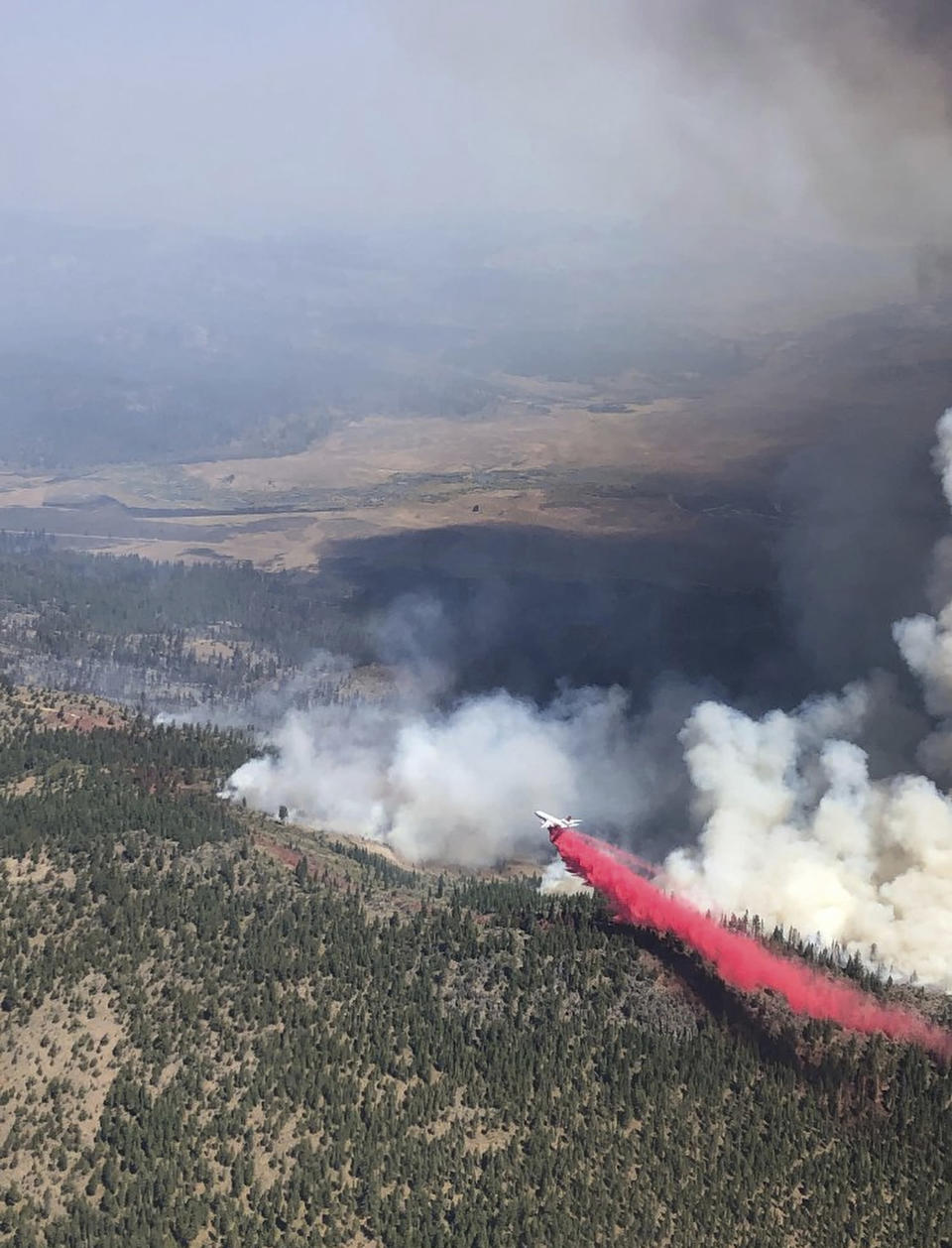 This Saturday, Sept. 4, 2021, aerial photo provided by the United States Forest Service Lassen National Forest shows the Great Basin Team 1 Air Attack operations on Saturday on the Dixie Fire on the Horton Ridge in Plumas County, Calif. The Dixie Fire began in mid-July in the northern Sierra Nevada and is the second-largest wildfire in recorded state history. It has burned nearly 1,400 square miles (3,625 square kilometers) in five counties and three national parks and forests, according to Cal Fire. (Great Basin Team 1 Air Attack Operations/U.S. Forest Service via AP)