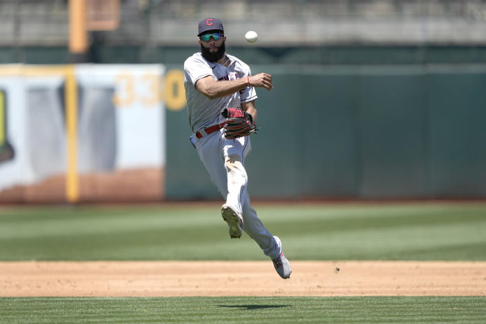 Cleveland Indians shortstop Amed Rosario throws to first base on a ball hit by Oakland Athletics' Aramis Garcia during the second inning of a baseball game Saturday, July 17, 2021, in Oakland, Calif. Aramis Garcia was out at first. (AP Photo/Tony Avelar)