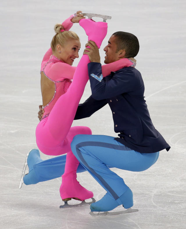 Aliona Savchenko and Robin Szolkowy of Germany compete in the pairs short program figure skating competition at the Iceberg Skating Palace during the 2014 Winter Olympics, Tuesday, Feb. 11, 2014, in Sochi, Russia. (AP Photo/Bernat Armangue)