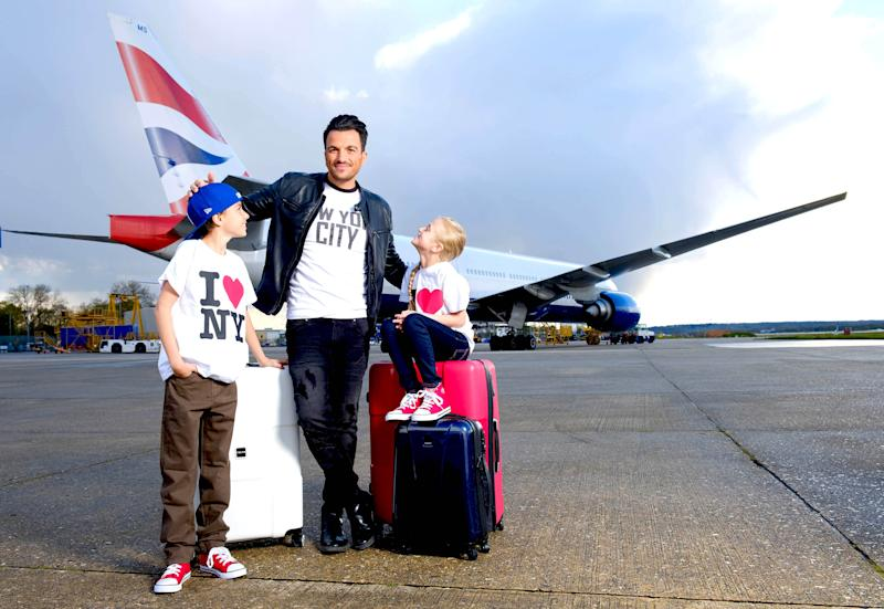 EDITORIAL USE ONLY Peter Andre and his children Junior and Princess on the tarmac at Gatwick Airport in front of a British Airways 777 to celebrate the launch of the airlineÕs new route from Gatwick Airport to New York, JFK, which starts today.