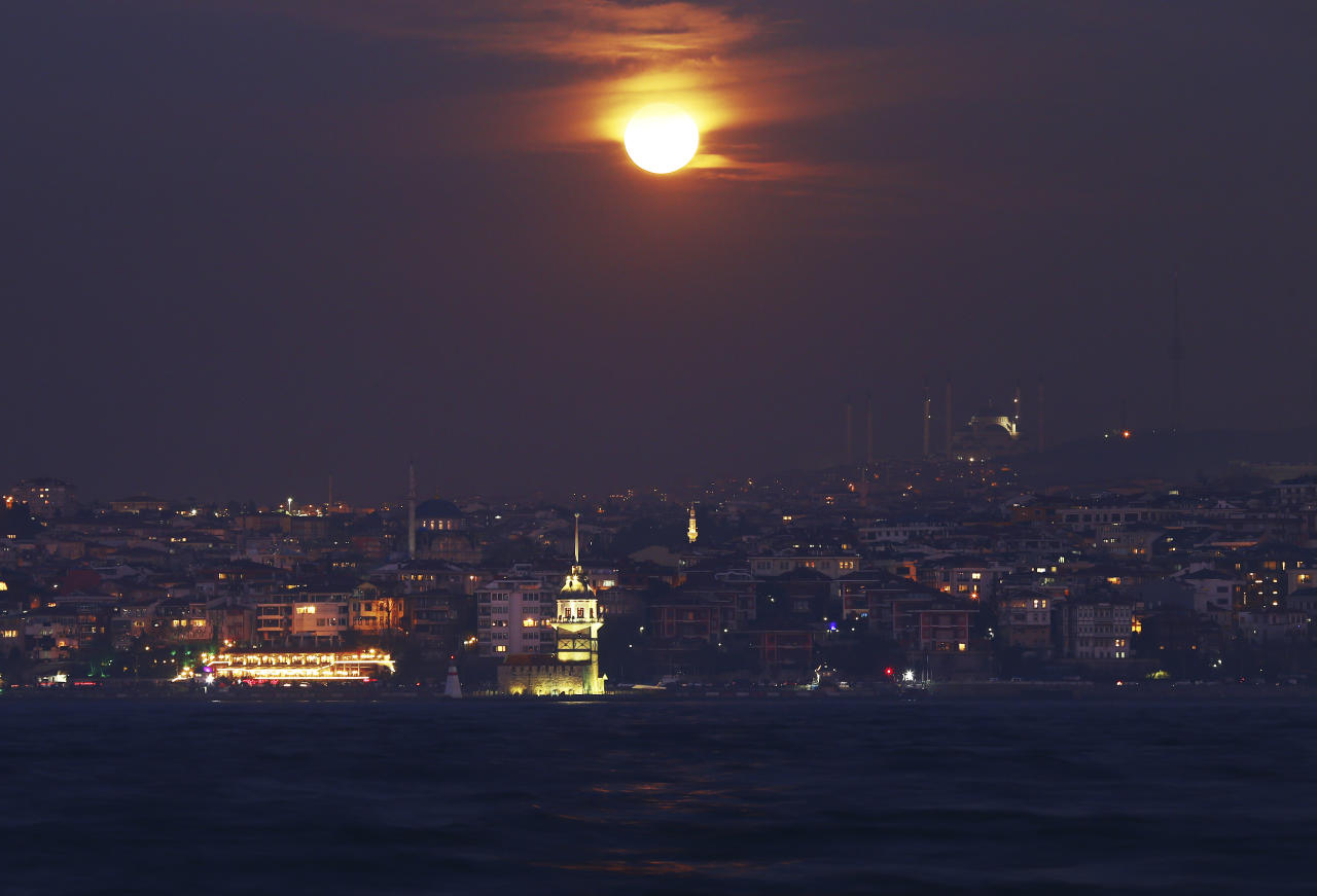 <p>With the Bosporus Strait separating Europe and Asia on the foreground, a super blue blood moon rises over Istanbul. It's the first time in 35 years a blue moon has synced up with a supermoon and a total lunar eclipse, or blood moon because of its red hue, all rolled into one celestial phenomenon. (AP Photo/Emrah Gurel) </p>