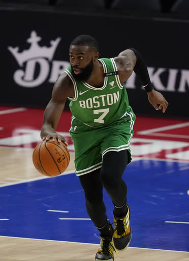 Boston Celtics guard Jaylen Brown brings the ball up during the first half of the team's NBA basketball game agains the Detroit Pistons, Friday, Jan. 1, 2021, in Detroit. (AP Photo/Carlos Osorio)