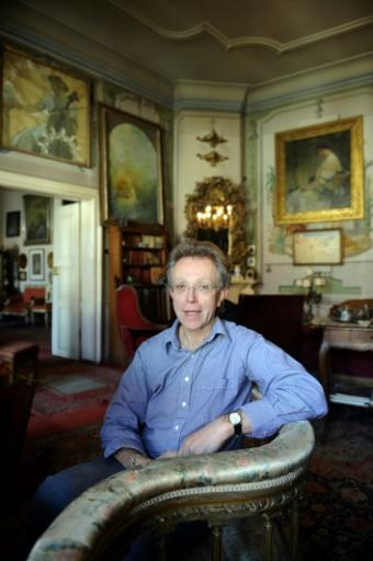 John Mucha, Alfons Mucha's grandson, poses at his apartment in Prague