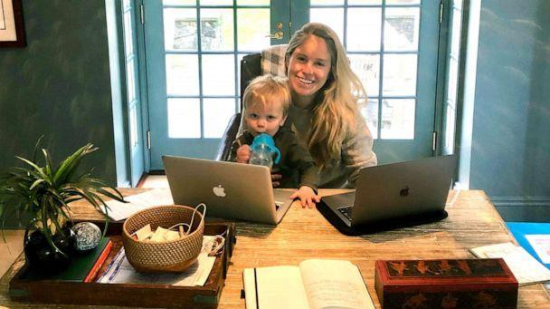 PHOTO: Sydney Williams sits behind her desk with her oldest son at her home in Greenwich, Conn. (Courtesy Sydney Williams)