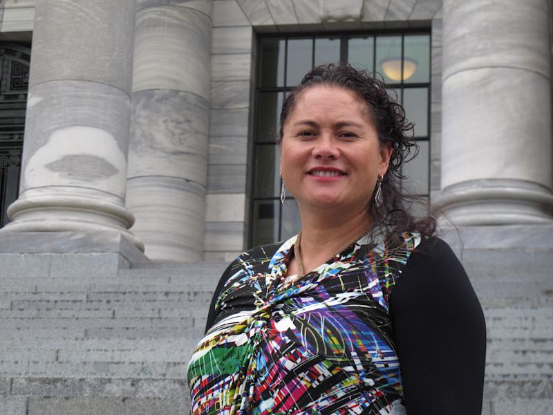 New Zealand lawmaker Louisa Wall, who sponsored the gay marriage bill, stands on the steps of Parliament in Wellington before voting for the same-sex marriage Tuesday, April 16, 2013. New Zealand has become the 13th country in the world and the first in the Asia-Pacific region to legalize same-sex marriage. Hundreds of jubilant gay-rights advocates celebrated at New Zealand's Parliament today after lawmakers vote 77 to 44 in favor of the gay-marriage bill. (AP Photo/Nick Perry)